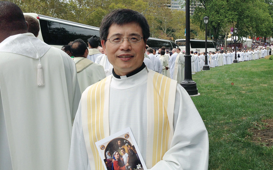 While studying at Catholic University of America, Father John Chen concelebrated Mass with Pope Francis in Philadelphia last year (Courtesy of J. Chen/U.S.)