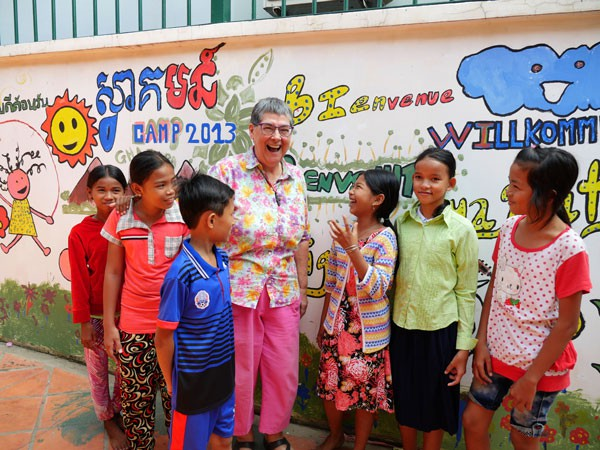 Maryknoll Sister Ann  Sherman, above, is surrounded by students from her English class for underprivileged Cambodian children.