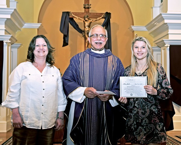 Anna Brest receives first-place award from Maryknoll Father Douglas May