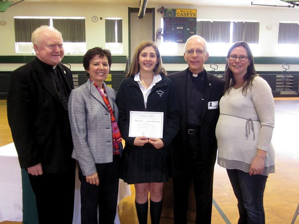Grace Wilson with (l. to r.) pastor Msgr. Philip Lowery, principal JoAnn Giordano, Maryknoll Father Robert Jalbert, teacher Tracy Varno. (Courtesy of St. James School