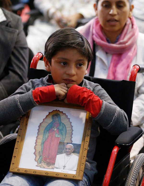 Boy in Juarez Mexico, waits for Pope Francis