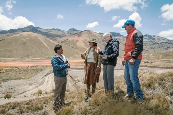 Maryknoll Sister confers with Condoraque village leaders in the altiplano of Peru