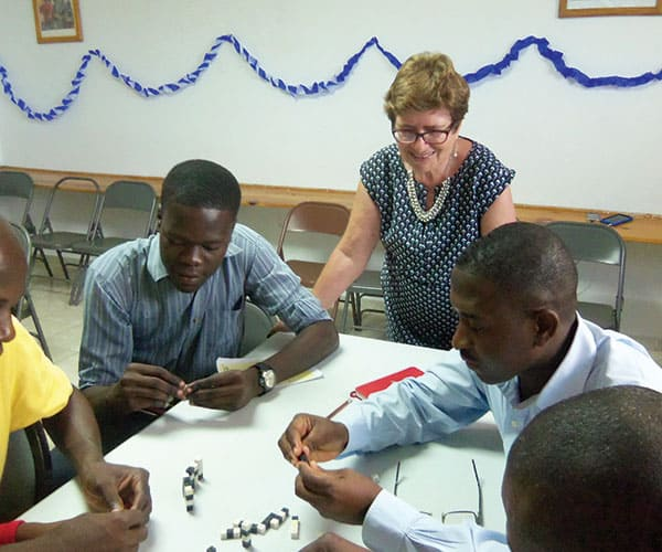 Affiliate Renate Schneider conducts a seminar to help Haitians solve local problems. Maryknoll Affiliates mark 25 years of mission.