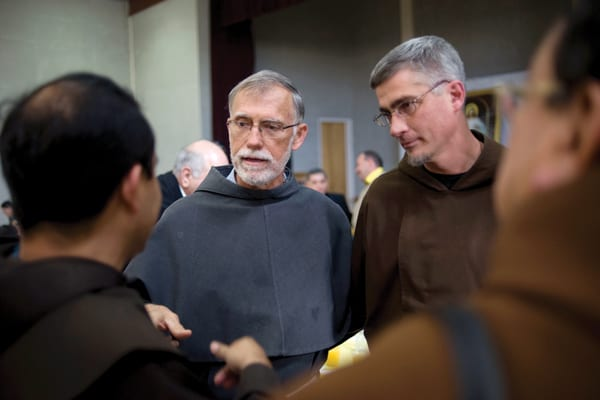 Wearing a gray Franciscan habit, Father Thomas Smith, left, who gave sanctuary at his church in Las Cruces, N.M., to undocumented immigrant Jorge Taborda, meets with a fellow Franciscan priest.