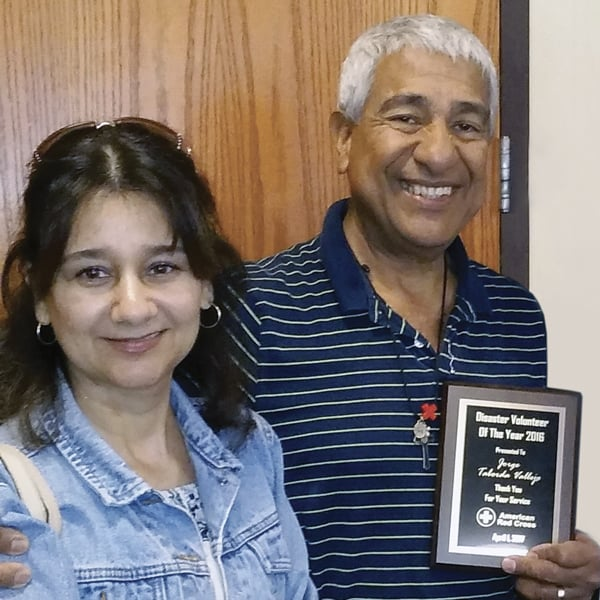Jorge Taborda, right, and his wife, Francia Benitez, pose for photo after he received the Red Cross volunteer of the year award in 2016.