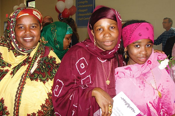 Former refugee Madina Dhahir Haji celebrated her eighth-grade graduation in 2009 with her mother, Zahara.