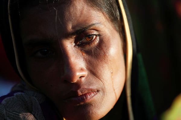 A Rohingya refugee who fled with her family from Myanmar cries after arriving at a camp in Bangladesh.