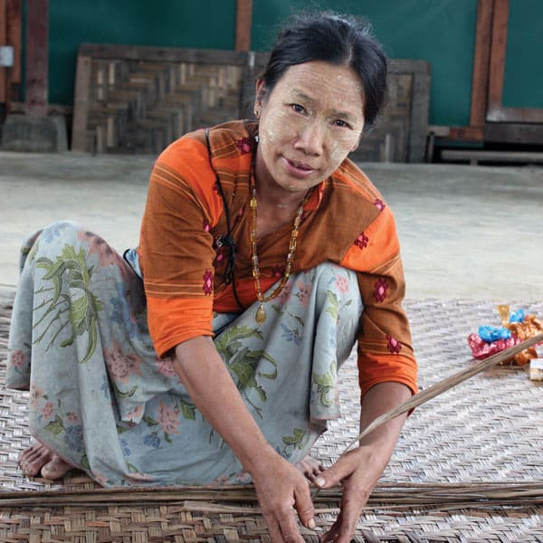 Mercy messenger:A woman displaced by fighting in north Myanmar (formerly Burma) weaves a mat in a refugee camp.