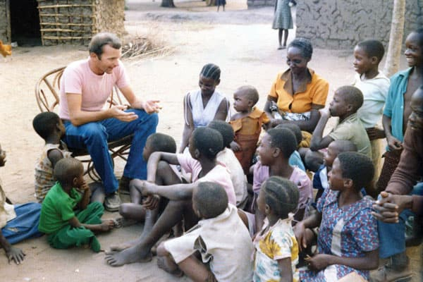 Father Michael Snyder, a Maryknoll missionary priest, engages with parishioners in Bunda, Musoma, Tanzania, when he was a young priest in 1983.