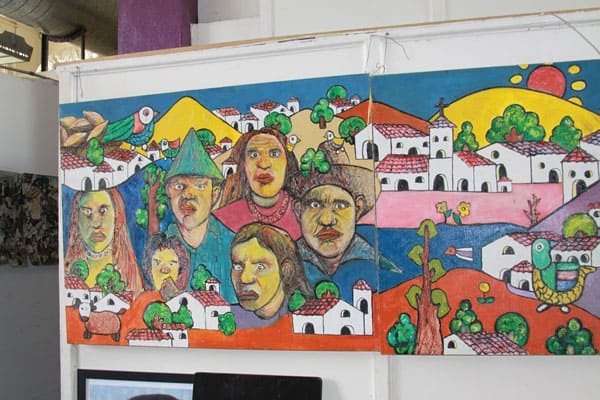 A mural in the colorful style of Mexican folk art greets visitors and guests on the first floor of Annunciation House shelter in the border city of El Paso, Texas.