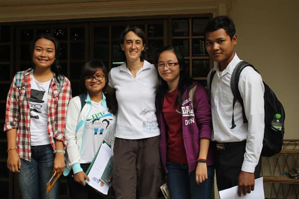 Maria Montello, a Maryknoll lay missioner from Atlanta, Georgia, in the center of four students she teaches at the Royal University of Phnom Penh in Cambodia.