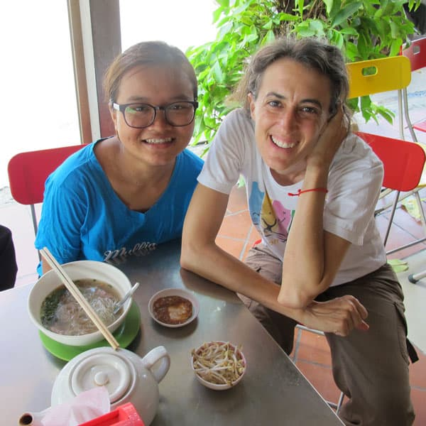 Maria Montello at lunch with a favored student, Raksmy, at a table in Phnom Penh, the capital of Cambodia.