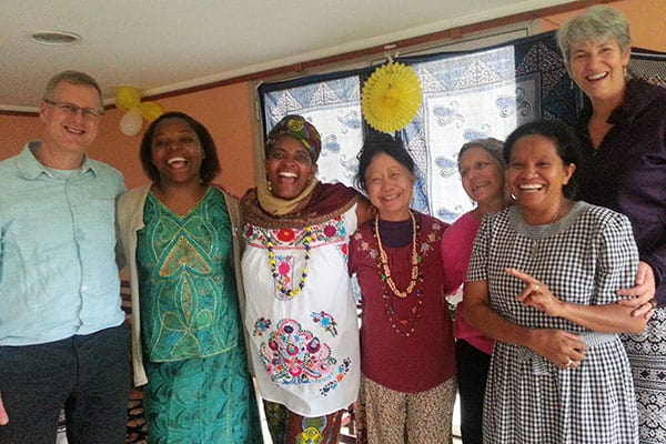 Trauma Healing - Father Maryknoll Dennis Moorman and Maryknoll Sister Efu Nyaki smile with women at Afya Holistico in Brazil.