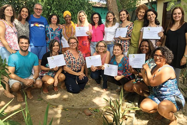 Trauma Healing - Father Moorman (blue shirt) and Sister Nyaki (yellow dress) congratulate those who completed a Somatic Experiencing training in João Pessoa. (Courtesy of D. Moorman/Brazil)