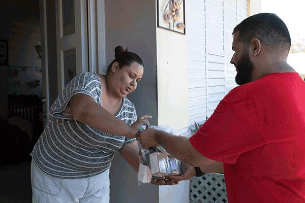 A volunteer from San Miguel parish in Utuado, delivers supplies to a family affected by Hurricane Maria. (Octavio Duran, OFM/Puerto Rico)