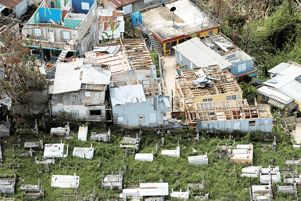 Destroyed homes next to a cemetery in Morovis, Puerto Rico. Months after Hurricane Maria, the situation remains dire. (CNS/Puerto Rico)