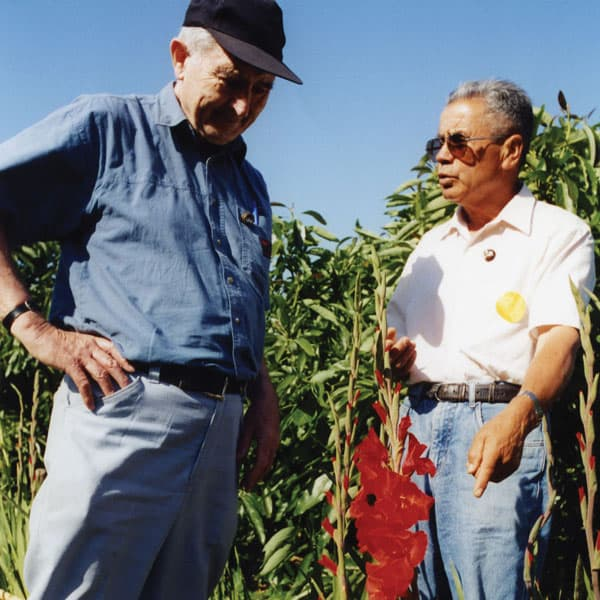 """Traveling up and down Chile, Father Hegarty (wearing cap) listened to the concerns of poor farmers and helped them """"discover the supernatural in human activities."""" (J. Fedora/Chile)"""