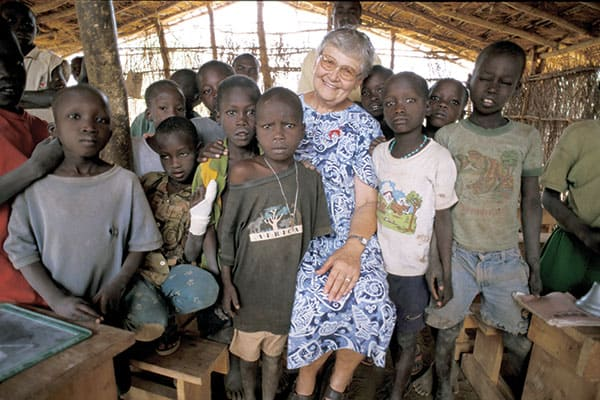 Maryknoll Sister Mary Ellen Manz smiles with students in southern Sudan. The missionary was a teacher in that African land for 25 years. (S. Sprague/S. Sudan)