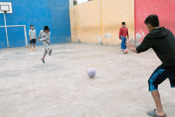 Teenage boys at Hogar Santa Maria put their best foot forward in a soccer game. Inspired by the work of Maryknoll Father Byrne, a group of Peruvian Maryknoll Affiliates continue supporting vulnerable children in the peripheries of Lima, Peru.