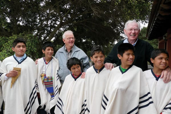 "Maryknoll Fathers Bernard ""Pete"" Byrne (right) and Philip Erbland visiting residents at Santa Maria Home for Boys in Lima in 2009. Inspired by the work of Maryknoll Father Byrne, a group of Peruvian Maryknoll Affiliates continue supporting vulnerable children in the peripheries of Lima, Peru."