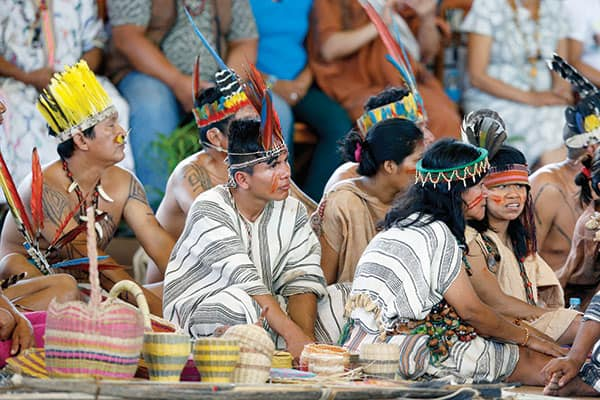 "Indigenous groups listen to Pope Francis call their lands ""holy ground"" during a visit in Puerto Maldonado."