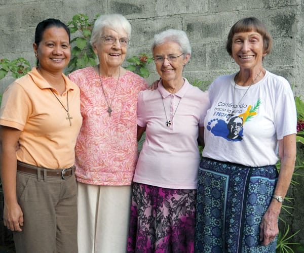 Maryknoll sisters who have recently served in El Salvador (l. to r.) Gloria Agnes, Cecilia Vandal, Angela Brennan and Mary Annel. Sister Brennan has been visiting prisoners in El Salvador for the last seven years.