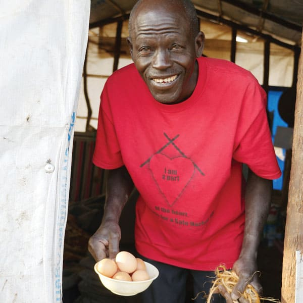 Catholic catechist Eugene Obwoya, a South Sudanese agronomist, gathers eggs from hens that are part of an income-generating program started by the Maryknoll Fathers and Brothers at the Palabek Refugee Settlement in Uganda.