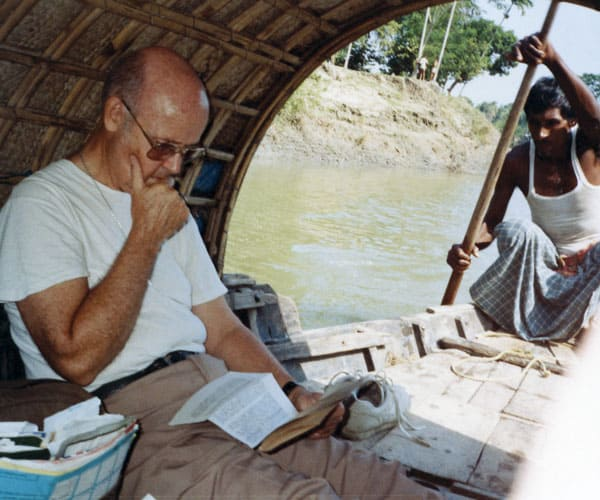 First Mission sending: Serving in Bangladesh, Maryknoll Father Lawrence Schanberger regularly got a ride from Sultan, a Muslim boatman who became his friend. (Maryknoll Mission Archives)