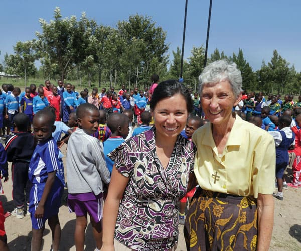 First Mission sending: Maryknoll Lay Missioner Guadalupe Petro (l.) and Maryknoll Sister Celeste Derr work in a school in Tanzania. (S. Sprague/Tanzania)