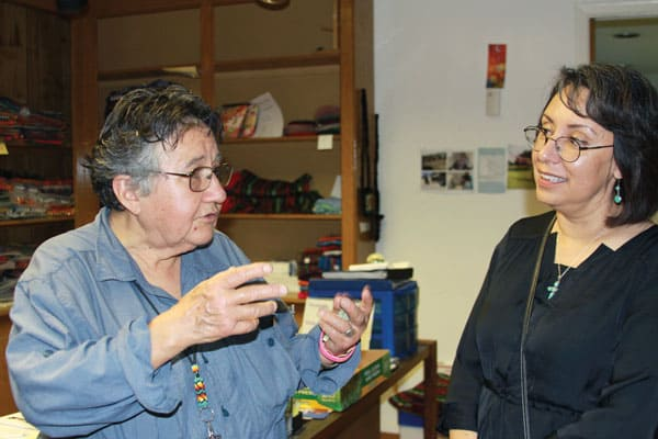 Maryknoll Sister Margaret Sierra (l.) talks with Leona Jewett, a teacher who visited Santa Catalina center. There, she is helping to empower women in Ciudad Juarez