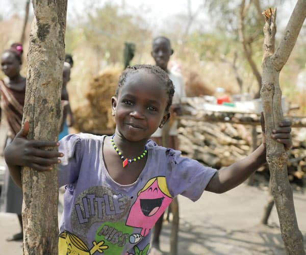 A young girl of the Acholi tribe from South Sudan plays at the Palabek Refugee Settlement.