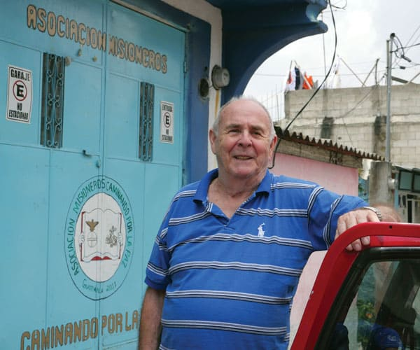 Ron Covey, a Maryknoll affiliate from Texas, stands outside the metal doors to Caminando Por La Paz (Walking Toward Peace) in Guatemala City.
