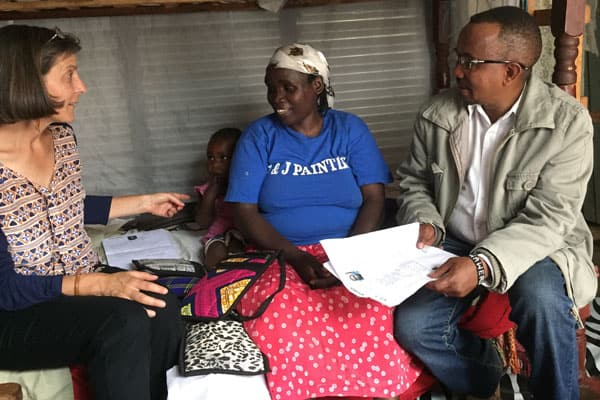 Maryknoll Lay Missioner Heidi Cerneka (left), whose work in Kenya involves helping imprisoned women, also makes time to work with refugees, such as the woman in the blue t-shirt. Cerneka was accompanied by Joseph Waweru, who worked for Jesuit Refugee Service.
