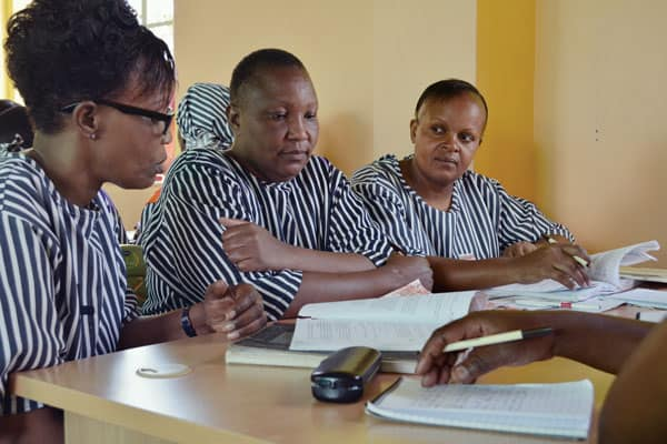 Imprisoned women inmates who are trained as paralegals to assist themselves and other prisoners with their criminal cases discuss strategy at a legal clinic in the Lang'ata Women's Prison in Nairobi, Kenya.
