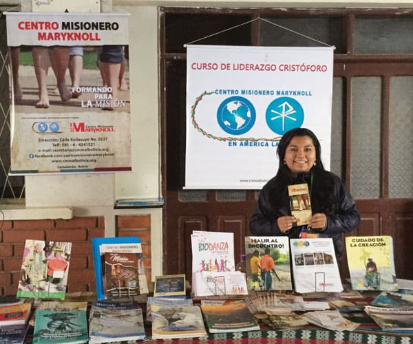 Silvana Martínez, a member of the Maryknoll Missionary Center for Latin America, staffed a booth at V CAM displaying Maryknoll resources for mission education and formation.
