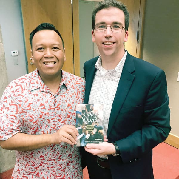Christopher Derige Malano, left, and Kevin Ahern, editors of God's Quad, display the Orbis book at its launch in New York in October. The books talks about catholic student communities in the college campus. (Courtesy of K. Ahern)C