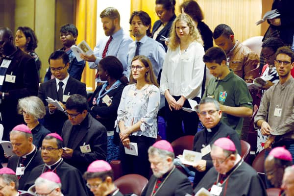 Listening, Discerning, Engaging Youth and Young Adults: Bishops and observers pray at the Synod of Bishops in October. (CNS/P. Haring/Rome)