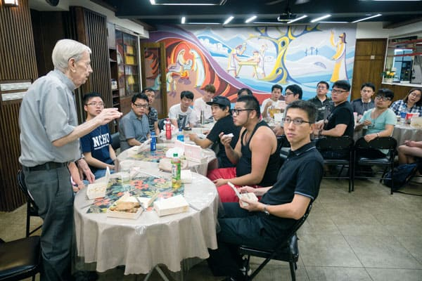 Father Doyle Helps Foster Catholic Friendship and Love in Taiwan: Father Alan Doyle welcomes Catholic singles for dinner at Friendship House in Taipei. (Nile Sprague/Taiwan)