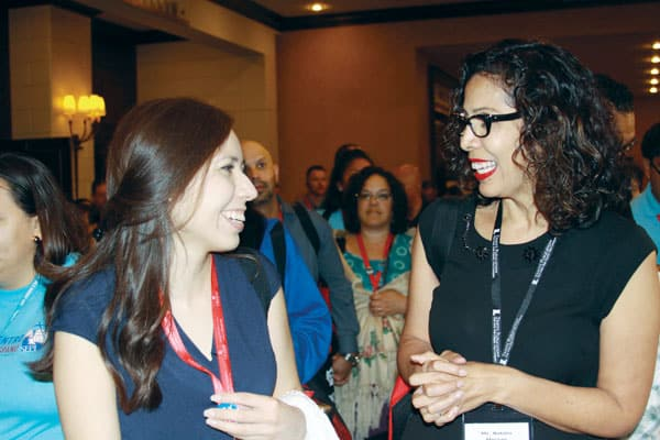 Lily Morales (left), coordinator of Hispanic ministry in Austin, Texas, shares ideas and finds solidarity with other Catholic Hispanic leaders like Natalia Moreau. (G. Soria/U.S.)