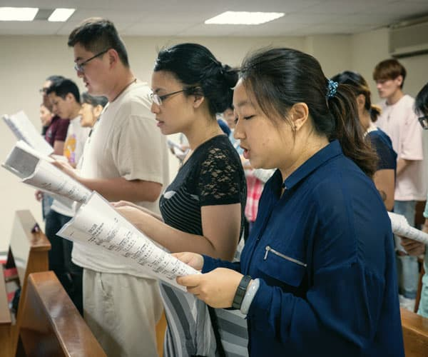 Father Doyle Helps Foster Catholic Friendship and Love in Taiwan: Singles worship at Saturday night Mass in the chapel at Friendship House in Taipei. (Nile Sprague/Taiwan)