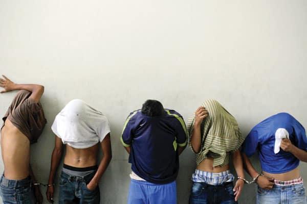 Barrio 18 gang members accused of killing a bus driver in San Salvador, El Salvador, are presented to media. (CNS/O. Rivera,EPA/El Salvador) Slug: El Salvador violence