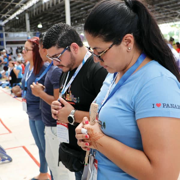 World Youth Day, 2019: Ernesto and Andrea Lopez, pilgrims from El Salvador, pray during a morning catechesis. (M. Chin/Panama)