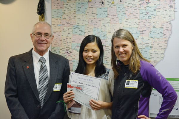 Heidi Maier, a 12th-grader at Beachwood High School in Beachwood, Ohio, is joined by her mother, Nina Maier, as she happily accepts the Bishop Patrick J. Byrne Award from Maryknoll mission promoter Deacon Paul Bork for earning first place among Division II student essay winners 2018. (N. Buford/U.S.)