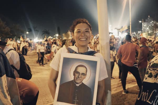 World Youth Day, 2019: After the pope's welcome ceremony, pilgrim Marcela Salguero holds an image of Saint Oscar Romero, one of the patron saints of World Youth Day. (M. Chin/Panama)