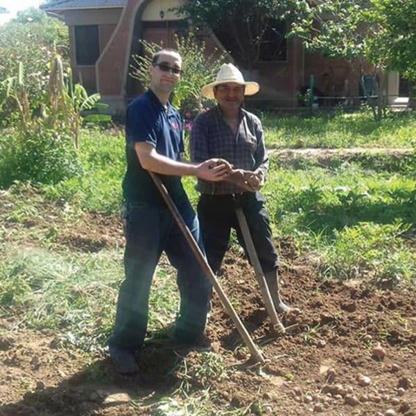 During his overseas training program in Bolivia, Brother Ryan Thibert helped harvest potatoes. (Courtesy of R. Thibert/Bolivia)