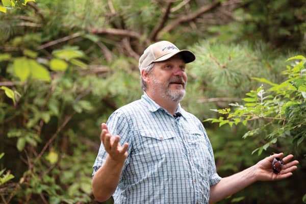 Chris Barton, a forester and professor at the University of Kentucky, explains during an Appalachia immersion trip what he and others are doing to restore sections of forest devastated by strip mining. Photo by O. Duran/U.S.