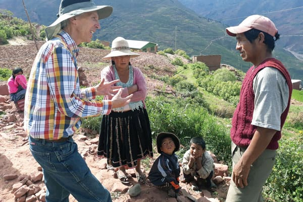 Maryknoll Lay Missioner Joseph Loney (left) talks with community leader Sebastian about helping the families in Sachacaymane repair the irrigation system. The missioners were in the village initially to help a widow with six children. (J. Siyumbu/Bolivia)