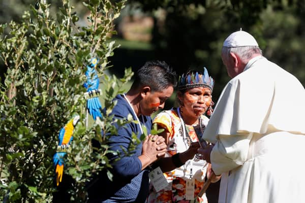 "Pope Francis greets members of an indigenous community of the Amazon during a celebration marking the feast of St. Francis in the Vatican Gardens Oct. 4, 2019. Pope Francis called on participants to listen and discern ""guidance of the Holy Spirit."" (CNS/Yara Nardi, Reuters)"