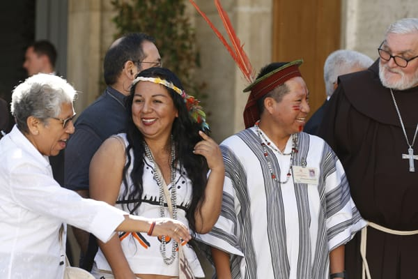 Participants leave a session of the Synod of Bishops for the Amazon at the Vatican Oct. 9, 2019. The first week of the Amazon Synod saw support for key synod themes emerge, including the priestly ordination of married indigenous men, impassioned pleas for respect for indigenous culture and denunciations of violence against the Earth. (CNS/Paul Haring)