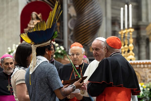 Pope Francis meets an indigenous man during a prayer service at the start of the first session Synod of Bishops for the Amazon at the Vatican Oct. 7, 2019. Some bishops say indigenous culture can enrich Catholic liturgy.(CNS/Vatican Media)
